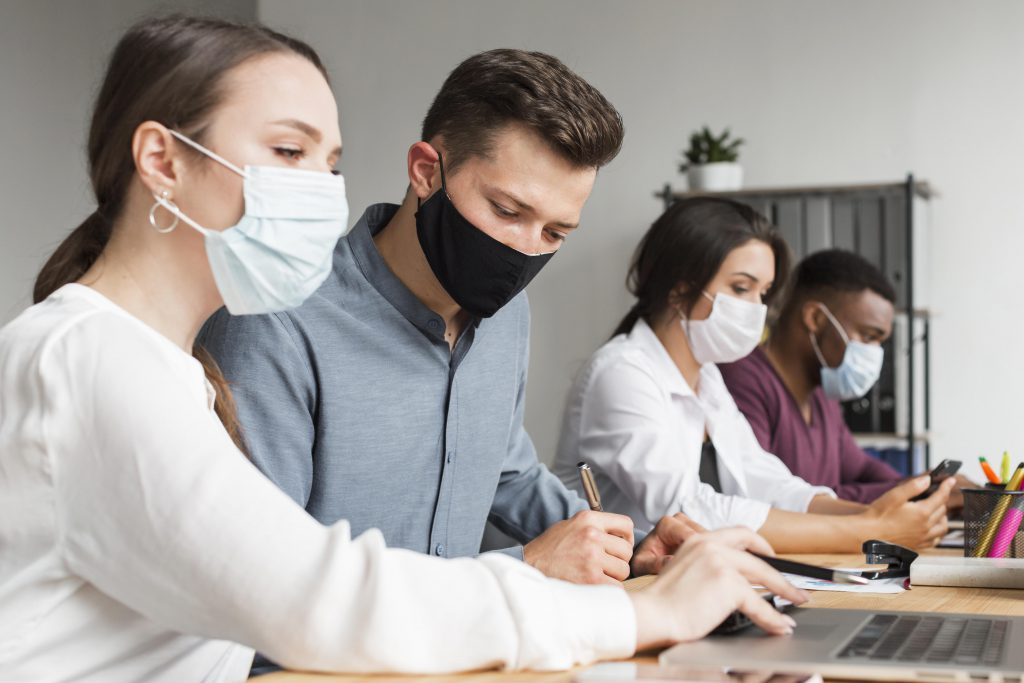 people-office-working-during-pandemic-with-masks